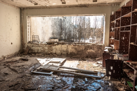 Water pouring down on wall in abandoned room in pripyat Stock Photo - 13611291