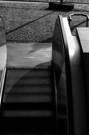Escalator at station in black and white photo