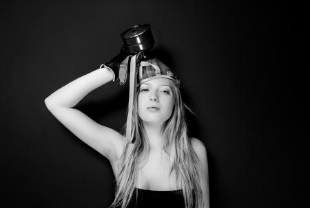 Girl in gasmask against dark wall photo