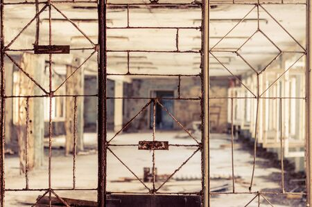 Vintage broken window with blurry corridor Stock Photo - 13611425