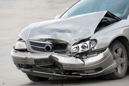 total loss: Damaged car on the road closeup Editorial