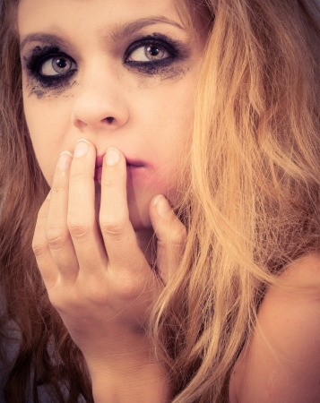 A sad blond girl with terrified expression closeup Stock Photo - 14302346