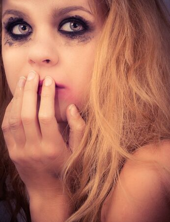 A sad blond girl with terrified expression closeup Stock Photo - 14302357