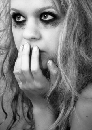 A sad blond girl with terrified expression closeup Stock Photo - 14302439
