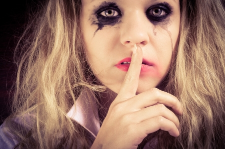 A sad blond girl with terrified expression closeup Stock Photo - 14302456