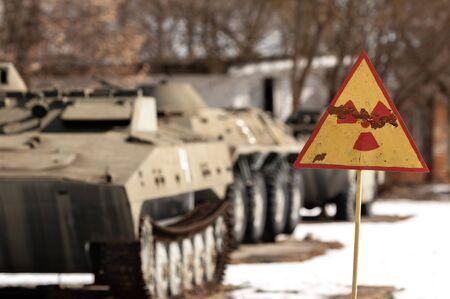 radiation hazard sign: Radiation hazard sign with tanks Stock Photo