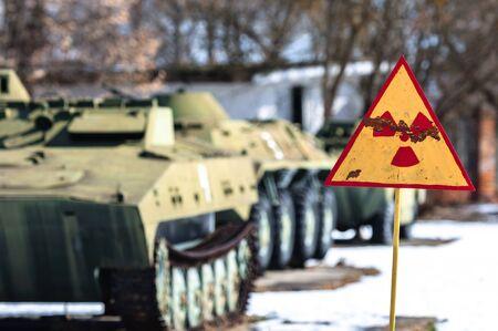 Radiation hazard sign with tanks photo
