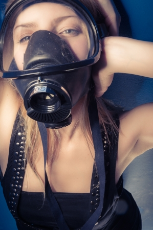 Young woman with a mask closeup Stock Photo
