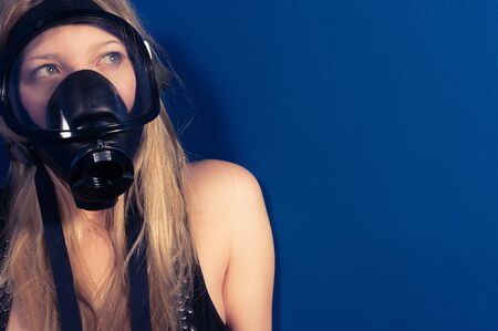 safety: Young woman with a mask closeup Stock Photo