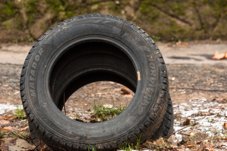 Truck tyre in the mud polluting the land photo