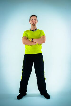 Young fitness instructor on white isolated background photo
