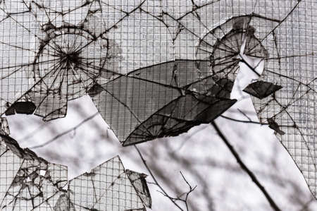 broken glass background in dark colors photo