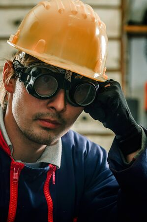 Hard working man in helmet Stock Photo - 15944107