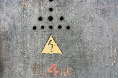 Danger, high voltage sign on steel background Stock Photo - 16000530