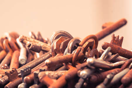 A large group of rusty keys closeup photo