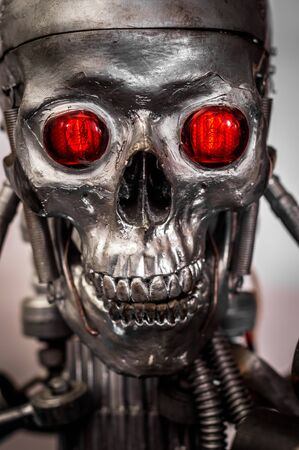 terminator: War machine with red eyes against isolated white background Stock Photo