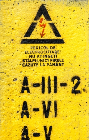 Danger, high voltage sign in yellow photo