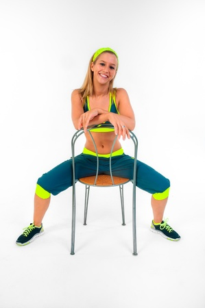 Young fitness instructor sitting on chair photo