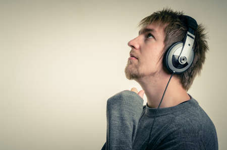 Young man with headphones against white background Stock Photo - 17017866