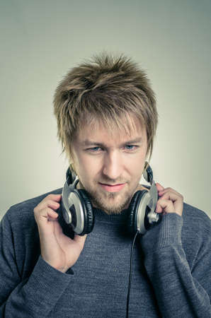 Young man with headphones against white background Stock Photo - 17017893