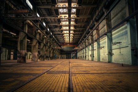 old factory: An abandoned industrial interior in dark colors