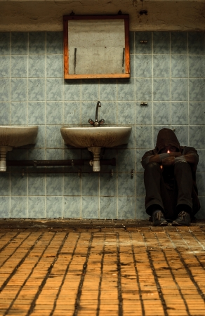 An abandoned industrial inter with a depressed man Stock Photo - 17022884