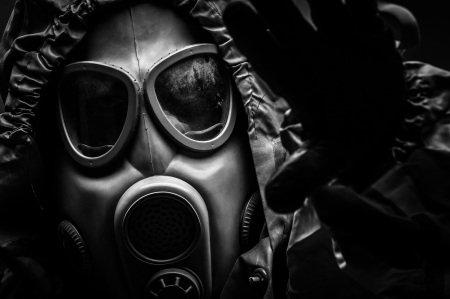 Man in protective suit against dark background Stock Photo - 17017903