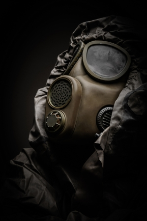 Man in protective suit against dark background Stock Photo - 17017984