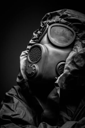 Man in protective suit against dark background Stock Photo - 17017955