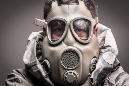 Man in protective suit against dark background Stock Photo - 17017837