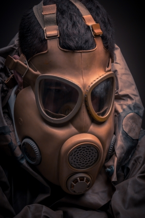 Man in protective suit against dark background Stock Photo - 17017888