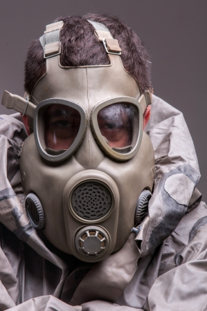 chernobyl: Man in protective suit against dark background