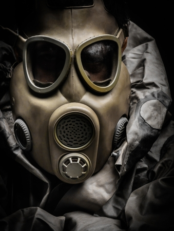 Man in protective suit against dark background photo