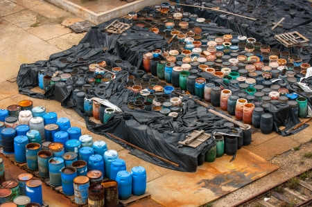 chemical warfare: Photo of a Chemical waste dump with a lot of barrels Stock Photo