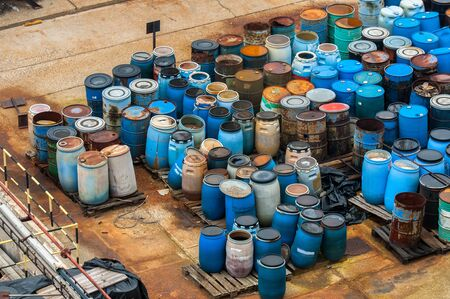 abandoned factory: Photo of a Chemical waste dump with a lot of barrels Stock Photo