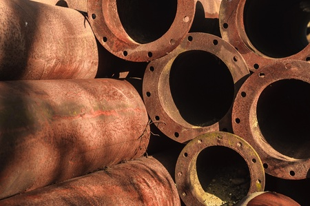 Rusty old pipes stacked up with natural light on them Stock Photo - 17021365