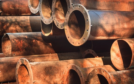 Rusty old pipes stacked up with natural light on them Stock Photo - 17022851