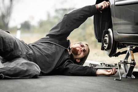 Handsome young man repairing car Stock Photo - 17017953