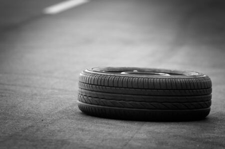 Car tire on the road outdoors photo