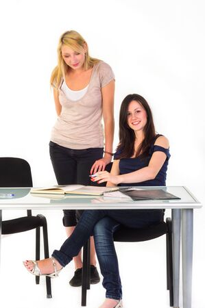 Two beautiful student girls getting ready for school isolated photo