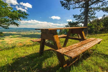 without people: Wooden bench without people outdoors Stock Photo