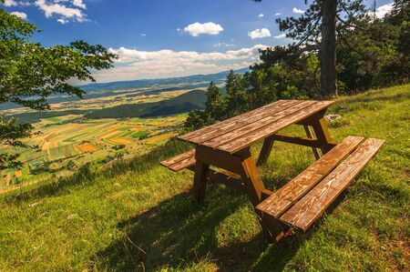 Wooden bench without people outdoors photo
