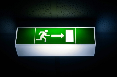 Dark exit sign with vibrant light closeup photo Stock Photo - 17682416