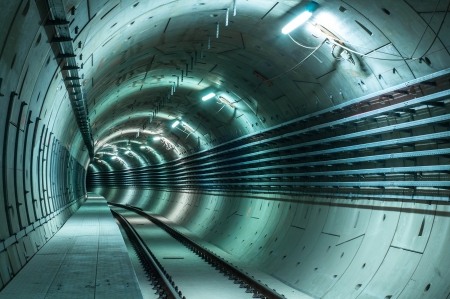 Underground facility with a big tunnel leading deep down photo