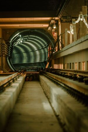 Underground facility with a big tunnel leading deep down Stock Photo - 17682956
