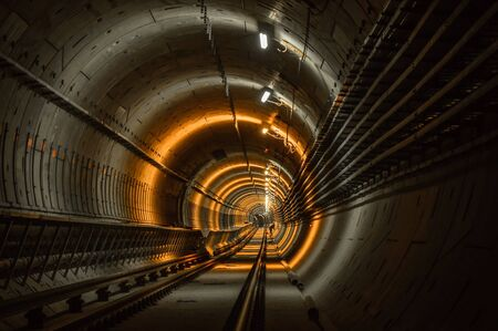 Underground facility with a big tunnel leading deep down Stock Photo - 17682715
