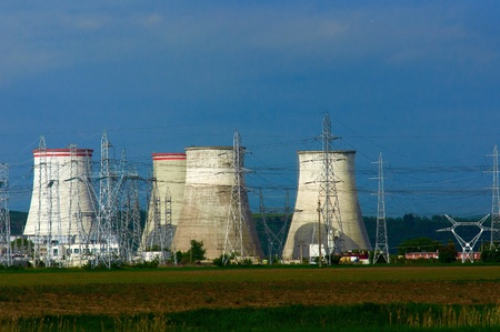 Nuclear power plant with electric pylons and blue sky photo