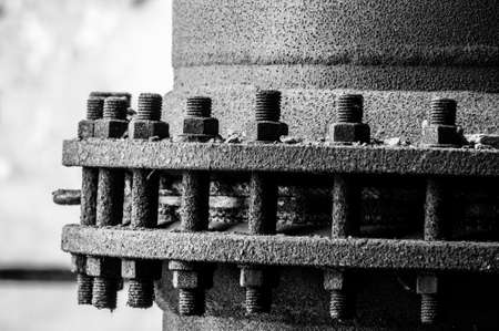 Cogs and nuts in black and white on pipe Stock Photo - 17684469