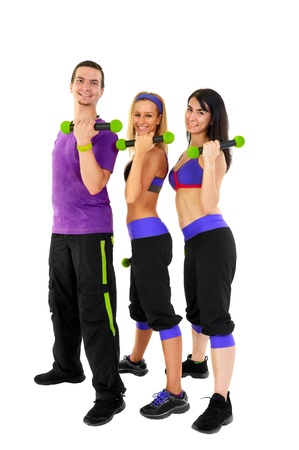 Young Fitness Instructors against white background in studio photo