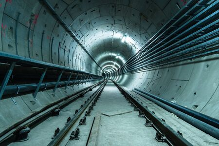Underground facility with a big tunnel leading deep down Stock Photo - 18044414